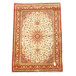 Persian fine tabriz red ground rug, central medallion on ivory field, interlaced foliate, guarded border with repeated stylised floral motif, 162cm x