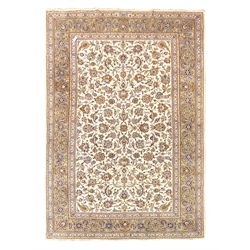 Persian Kashan ivory ground rug, decorated with a central herati motif leading in to interlaced scrolling foliate on an ivory field, guarded grey boa