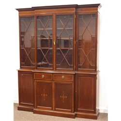 Edwardian mahogany break front bookcase on cupboard, projecting cornice above mahogany banded frieze, four astragal glazed doors, two short drawers a