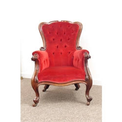 Victorian mahogany framed armchair, scroll carved arm supports on cabriole legs, upholstered in red buttoned fabric, W66cm