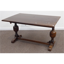 Early 20th century oak extending dining table, twin baluster supports joined by a singe stretcher, 'The Ee-zi-Way one motion extending dining table'