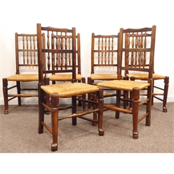 Harlequin set six 19th century oak Lancashire spindle back dining chairs, shaped cresting rail, rush seat raised on tapering front and square chamfer