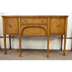 Edwardian mahogany break bow front sideboard, cross banded top above two drawers, enclosed by two cupboards, square tapering supports on peg feet, W1