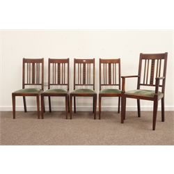 Five (four + one) early 20th century oak dining chairs, drop in seat cushions upholstered in green velvet, square tapering front supports, stamped 'J
