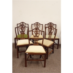 Six early 19th century mahogany Chippendale style dining chairs, shaped cresting rail, pierced splat with thistle motif, drop in seat cushions, raise