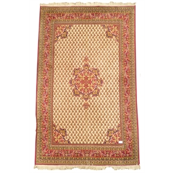 Central Asian design finely knotted red ground rug, floral medallion, repeating boteh motif on beige field, guarded boarder with floral decoration, 2