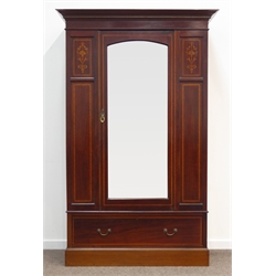Edwardian inlaid mahogany wardrobe, projecting cornice with checkered inlay, arched bevelled glazed mirror door, panels with fruit urns and ribbon in