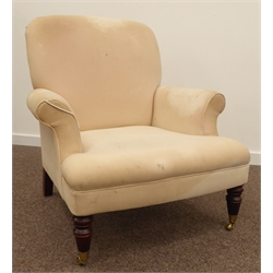 Mid 20th century Georgian style mahogany framed arm chair, upholstered in beige fabric, turned front supports terminating in brass cup castors, W86cm