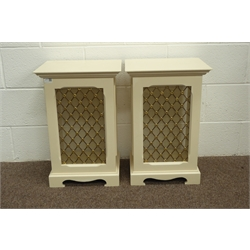 Pair of white painted speaker cabinets, projecting cornice, brass grill decorated with flower heads, bracket feet