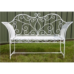 White painted open work wrought metal garden bench, W145cm