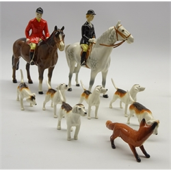 Beswick pottery 9 piece hunting group comprising Huntswoman on grey horse No. 1730, Huntsman on brown horse No. 1501, 6 hounds and a fox