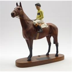 Beswick model of Arkle with Pat Taafe up No. 2084 from the Connoisseur series on a wooden base