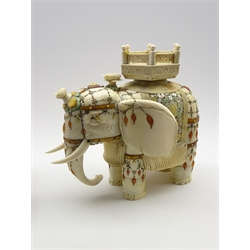 Japanese Meiji period signed model of an ivory and Shibayama elephant, standing with its trunk lowered, with howdah and decorated with mother of pearl and coloured hard stones, signature to base of foot H29cm x L30cm and on a wooden plinth
