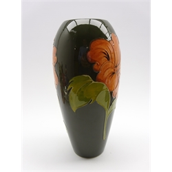 Walter Moorcroft oviform vase decorated with Hibiscus pattern on a green ground, initials to base H31cm