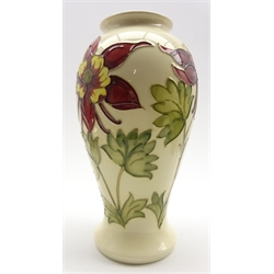 Walter Moorcroft oviform vase decorated with red Columbine pattern on a cream ground, initials to base H26cm