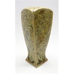 Martin Brothers stoneware vase of square tapering form decorated with flowers and trailing leaves on a beige ground, incised mark 'R W Martin & Bros. London and Southall 8-1889'  H32cm