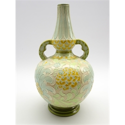 Burmantofts Faience two handled vase with an incised floral design in yellow, pale green and blue etc H35cm