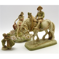 Royal Dux figure of a boy on a plough horse H35cm, a Royal Dux water lily bowl with classically draped female figure H30cm and a small Royal Dux group of 2 children embracing H14cm all in blush ivory and with pad marks