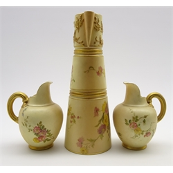 Royal Worcester ewer painted with sprays of flowers and gilded loop handle on a blush ivory ground. Shape 1047 and date code for 1904, H26cm and 2 small Worcester jugs Shape 1094 H14cm (3)