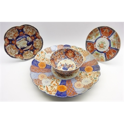 Large late 19th Century Japanese Imari pattern charger decorated with panels of flowers in orange, blue etc. D55cm 2 smaller Imari plates and a bowl