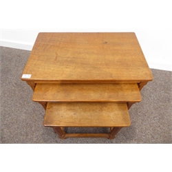 Nest of three Robert 'Mouseman' Thompson adzed oak tables, each with octagonal supports, stretchers and mouse signature, W61cm