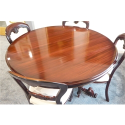Helvetica Victorian style french polished mahogany dining table, circular moulded top, raised on a central hexagonal column, three splayed floral scroll decorated feet, (131cm x 131cm, H74cm) and four mahogany balloon back chairs with reupholstered seats and reeded front supports, (W50cm)