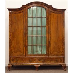 Quality mid 20th century walnut triple wardrobe, projecting stepped arched pediment above central glazed door, enclosing hanging rail, and two cross banded panelled doors, two cross banded drawers to base, cabriole supports, W180cm, H211cm, D50cm