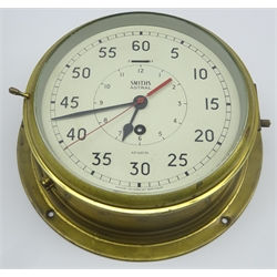 Smiths Astral ship's brass cased bulkhead clock, the painted 20cm dial with Arabic numerals, the inner chapter ring marking the hours with centre sweep seconds hand to the outer chapter ring, No.160174, D27cm