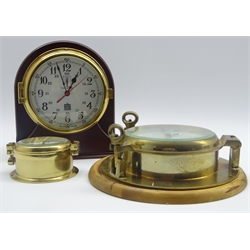 Sewills Radiomaster ship's brass cased bulkhead clock, the 14cm 24-hour dial with Arabic numerals and centre sweep seconds hand, mounted on mahogany stand as a mantel clock H23cm and two other modern ship's brass cased clocks with quartz movements, one marked 'FCC Precision' (3)