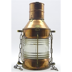 Ship's copper and brass masthead light labelled 'Eli Griffiths & Son Birmingham No.C920', with caged clear glass reflector, electrically powered, H54cm
