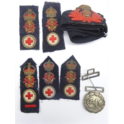 Effra; ;WW1 British Royal Navy officer's two-piece belt buckle with king's Crown insignia, together with Royal Navy female medical officer's cap band and five number one dress epaulettes/cloth badges