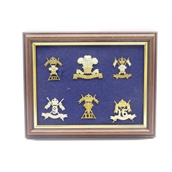Six mounted and framed cap badges for 12th Lancers, 12th Royal Lancers, 9th-12th Lancers, 9th Lancers, 21st Lancers and 16th The Queens Lancers