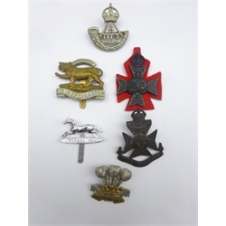 Six cap badges including Durham Light Infantry, 12th London Rangers, Leicestershire Regiment, 15th/16th London Westminsters (KRRC) etc