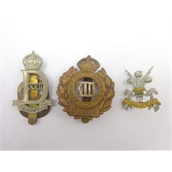 Three cap badges - 22nd Dragoons, POW 3rd Carabiniers and 13th Hussars