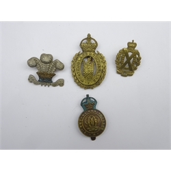 Four cavalry cap badges - Queens Own Hussars, Wiltshire Yeomanry, Scottish Horse and Westmorland & Cumberland