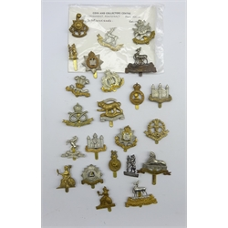 Twenty-three cap badges for various regiments including Warwickshire, Norfolk, Royal Lincolnshire, Notts & Derby, Devonshire etc, all thought to be restrikes