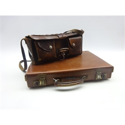 Stitched leather cartridge bag of oblong form with two pouch compartments to the front and carrying strap W31cm and leather briefcase
