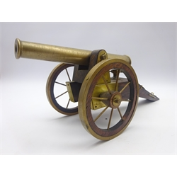 Brass model of a field cannon mounted on an oak carriage with spoked wheels L51cm