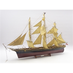 Model of the three masted clipper ship 'Cutty Sark', with black and brown painted wooden hull, simulated planked decking, full rigging and deck fittings L110cm, on stand on open display