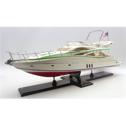 Point-of-sale promotional model of a Sunseeker Manhattan motor yacht by Besp-Oak Furniture, on fixed stand L87cm