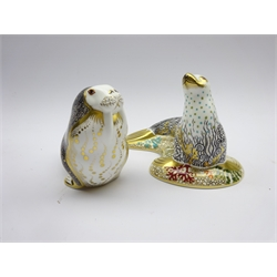 Two Royal Crown Derby paperweights 'Russian Walrus'  and White Sea Lion' both boxed and with gold stoppers