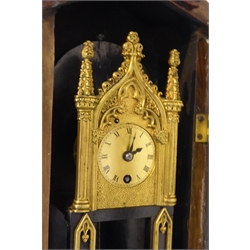Small mid 19th Century wall clock in a walnut case, with carved pediment and apron, guilt dial with Roman numeral chapter ring enclosed by ornate guilt metal arch and Corinthian columns, the case baring paper label en verso reading 'This clock was stolen at the siege of Sebastopol from the palace of the prince Gortschaskoff during the Crimean war' H59cm