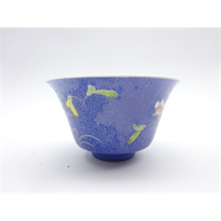 Chinese porcelain bowl with Qianlong reign mark painted with famille rose enamels with floral sprigs on a blue ground incised with scrolling foliage, bears 6 character reign mark D10cm
