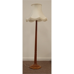 'Mouseman' Yorkshire oak standard lamp by Robert Thompson of Kilburn, octagonal column and stepped platform base, carved with mouse signature, with decorative cream tasseled shade, H167cm (Including shade)