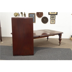 Large Victorian mahogany extending dining table, rectangular moulded top having rounded corners, raised on five turned carved baluster supports terminating in brass cup castors, with two additional leaves, bearing plaque for 'Samuel Hawkins Patentee 54 Bishopsgate street London' 250cm x 151cm, H73cm (With one leaf)