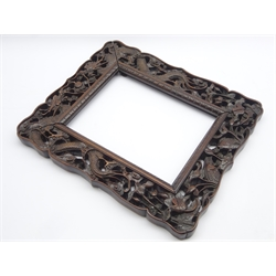 Late 19th/20th Century Chinese carved hardwood picture frame with dragon, fish and floral decoration 36cm x 31cm overall