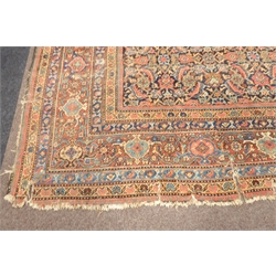 Large antique Persian Tabriz design ground rug, repeating floral design on red field, double guarded border with repeating interlaced motif, 596cm x 401cm