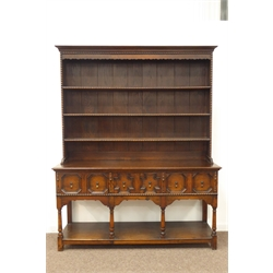 Early 20th century Jacobean style oak dresser, projecting cornice over three hight high plate rack with beaded moulding, moulded rectangular top to base over three geometric fielded panelled drawers, turned supports united by pot board base, W168cm, H210cm, D54cm