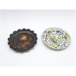 Early 19th Century earthenware plate with landscape and flowers, possibly Ferrybridge D16cm and a Tole ware plate painted with bird, flowers etc D17cm