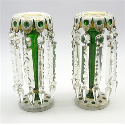 Pair of 19th Century Bohemian white and gilt overlaid green glass mantel vases hung with button and spear cut lustre drops H26cm